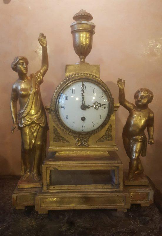 Orologio in legno dorato Impero